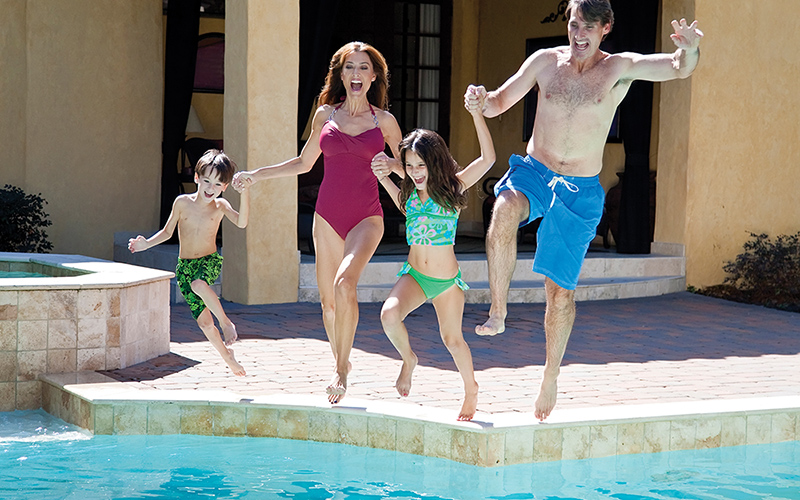 Family Jumping Into Pool Together