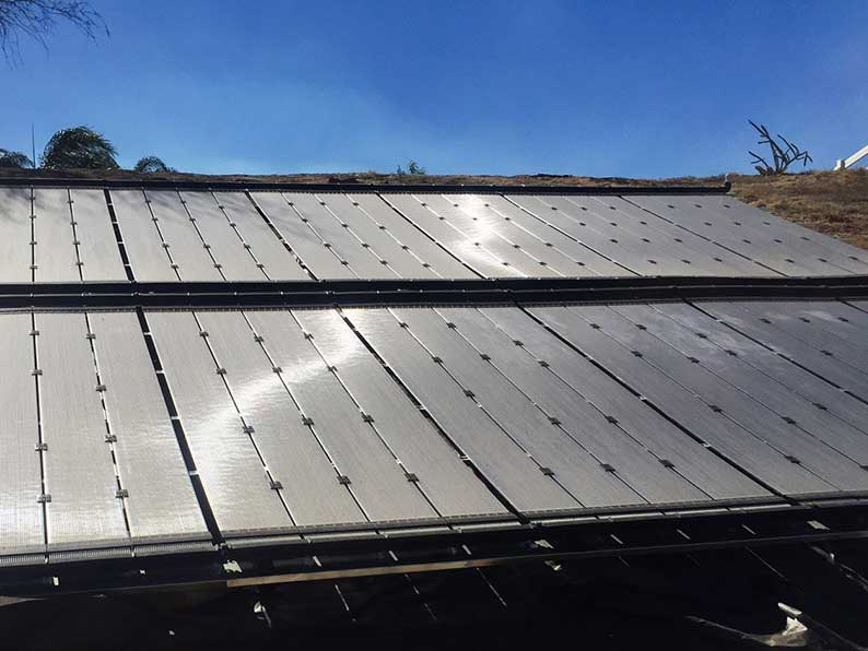 EcoSpark solar pool heating system on a ground rack