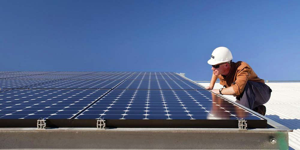 Man Doing Solar Panel Inspection