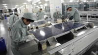 Solar panel manufacturing in a Chinese warehouse