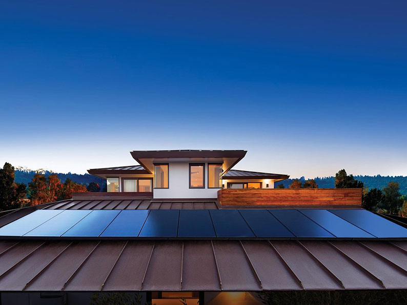 SunPower solar panel system on a house with dusk setting in