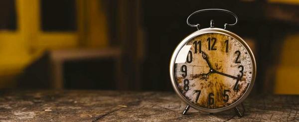 Vintage clock on a wood table